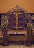 Flowers and table. Wooden table between flowers in rusty flowerpots stock photography