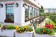 Flowers and tables of outdoor summer cafe royalty free stock photo