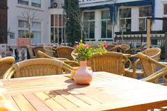 Flowers on the tables of street cafes. Royalty Free Stock Photography