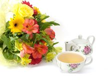 Flowers and tea. Bouquet and tea isolated on white background Royalty Free Stock Photos