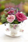 Flowers in a teacup. A table decoration comprised of a bunch of flowers in a teacup stock photography