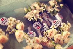 Flowers with team bride badge Royalty Free Stock Images