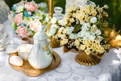 Flowers, teapot, sugar and marshmallows on a tray on the table Stock Images