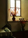 Flowers in the temple. Flowers, candles and a Bible in a window inside the evangelical church from Hermannstadt, Transylvania Stock Photography