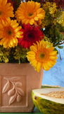 Flowers in a terracota vase. Sunflowers in a terracota vase Royalty Free Stock Photography