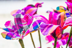 Flowers. There are plenty of beautiful colorful flowers made ​​from scraps of colorful fabric Royalty Free Stock Photo