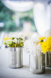Flowers in tin can Stock Images