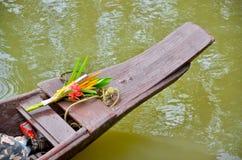 Flowers to Buddhist monk Stock Photo