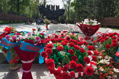 Flowers to the eternal fire at the memorial. In Park of 28-Panfilov's Guardsmen. Celebration of anniversary of Victory Day. Almaty. Kazakhstan stock images
