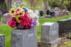 Flowers on a tombstone in a cemetary Stock Image