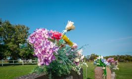 Flowers on a tombstone. In a graveyard in Quebec Royalty Free Stock Photos