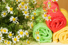 Flowers and towels Royalty Free Stock Photos