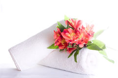 Flowers and towels. Isolated on white Stock Photo