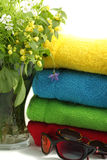 Flowers and towels. Flowers towels and sunglasses on light background Royalty Free Stock Photos