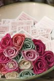 Flowers and train tickets Stock Image