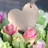 Flowers for valentines or mothers day. Heart shaped mothers day card Stock Images