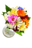 FLOWERS VASE. Beautiful colourful bouquet of flowers in a transparent glass vase Stock Image