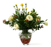 Flowers in vase. Bouquet of flowers with lots of greens in a transparent glass vase with pink glass beads and water Stock Photography