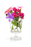 Flowers in vase. All kind of difference sping flowers in glass vase over white background Royalty Free Stock Photos