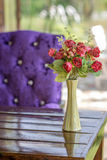 Flowers in Vase. A vase of artificial flowers on the table Stock Image