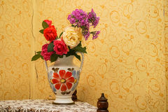 Flowers in a vase. Beautiful flowers in a vase on the shelf Stock Photography
