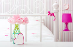 Flowers in vase in a bedroom. Royalty Free Stock Photography