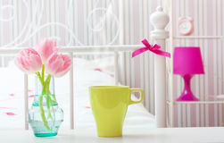 Flowers in vase in a bedroom. Stock Photography