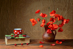 Flowers in a vase with a book Royalty Free Stock Photo