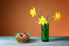 Flowers in a vase and Easter eggs Royalty Free Stock Image