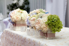 Flowers in the vase. Elegance table set up for wedding Stock Photos