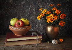 Flowers in a vase and fresh apples Stock Photos