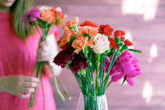 Flowers in a vase and a girl in the background royalty free stock photos