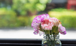 Flowers in vase near window Royalty Free Stock Photography