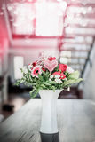 Flowers in vase on table in luxury living room Stock Image
