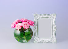 Flowers vase and vintage frame Stock Photo