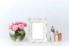 Flowers vase and vintage frame on white Royalty Free Stock Images