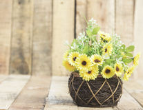 Flowers in a vase weave wood Stock Images