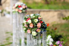 Flowers in a vase for the wedding ceremony. Stock Photo