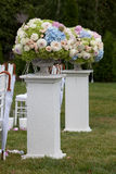 Flowers in a vase for the wedding ceremony outdoor. Stock Photos