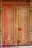 Flowers and vases. The picture on a temple door usually be Deva  some time is a flower and vase Stock Photo