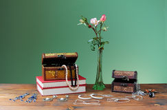 Flowers in vases and jewelery Stock Photo