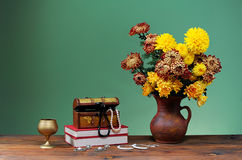 Flowers in vases and jewelery Royalty Free Stock Photo