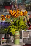 Flowers in vases used for home decoration. On blur background stock image