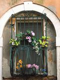 Flowers at Venice`s windows stock photography
