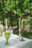 Flowers, vine glass and candle decoration Stock Images