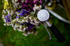 Flowers on vintage bicycle. Bouquet of flowers on vintage bicycle Stock Image