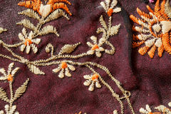 Flowers of vintage carpet stitching thread in old-style craftmenship style. Royalty Free Stock Images