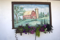 Flowers and wall painting. Nice painting on an old house with flowers royalty free stock images