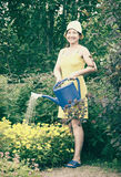 flowers watering woman στοκ φωτογραφία με δικαίωμα ελεύθερης χρήσης