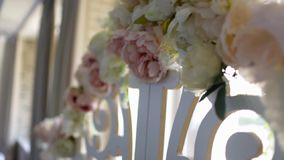 The flowers on the wedding arch stock video
